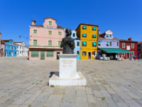 Central square and monument Baldassare Galuppi, byname Il Buranello on the famous island Burano. VФото lachris77 - Depositphotos