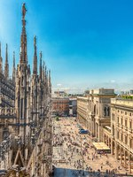 Италия. Миланский собор. Scenic aerial view over the city centre, as seen from the roof of the gothic Cathedral, Milan, Italy. Фото marcorubino - Depositphotos