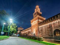 Sforza Castle (Castello Sforzesco) at night in Milan, Italy. The castle was built in the 15th century by Sforza, Duke of Milan.Фото BiancoBlue-Depositphotos