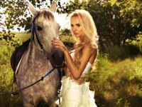 Beautiful blonde lady with posing with horse.  PawelSierak - Depositphotos