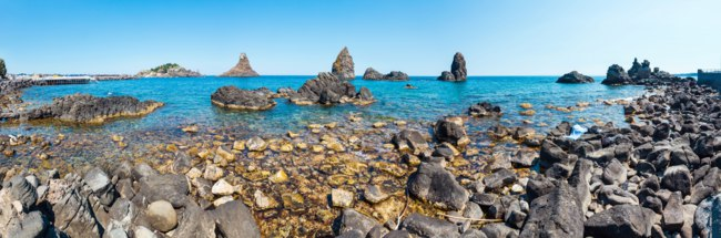 Lachea Island on Cyclopean Coast and the Islands of the Cyclops on Aci Trezza town (Italy, Sicily,10 km north of Catania). Фото wildman-Deposit