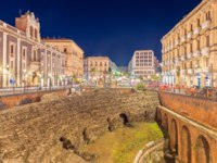 Италия. Сицилия. Катания. Evening view of The Roman Amphitheater in Catania. Ruins of an ancient theater. Sicily, Italy. Фото RS.photography - Depositphotos