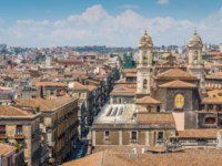 Panoramic sight in Catania from the dome of the Badia di Sant'Agata, with the Church of St. Francis of Assisi Immaculate. Sicily, Italy. Фото e55evu - Depositphotos
