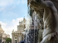 Италия. Сицилия. Катания. View of fountain and cathedral of Santa Agatha in Catania. Sicily. Italy. Фото Bareta - Depositphotos