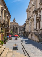 Италия. Сицилия. Катания. The scenic Via Crociferi in Catania on a sunny summer day, Sicily, southern Italy. Фото e55evu - Depositphotos
