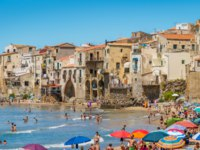 Италия. Сицилия. Панорама Чефалу. The picturesque Cefalu waterfront on a sunny summer day. Sicily, southern Italy. Фото e55evu - Depositphotos