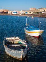 Fishing boats in the small harbour of the sea village Marzamemi, Southeast Sicily, in the early morning. Фото siculodoc - Depositphotos