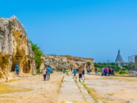 Италия. Сицилия. Сиракузы. People are walking through ruins of the Greek theatre in Syracuse, Sicily, Italy. Фото Dudlajzov - Depositphotos