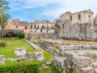 Greek Theatre of Syracuse Sicily. Temple of Apollo in Siracusa old town (Ortigia). Sicily, southern Italy. Фото e55evu - Depositphotos