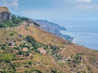 Италия. Сицилия. Таормина. Panoramic view from Castelmola, village situated above Taormina, on the top of the mountain Mola. Sicily. Фото e55evu-Deposit