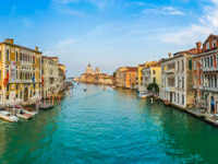 Италия. Венеция. Гранд Канал. Panoramic view of famous Canal Grande and Basilica di Santa Maria della Salute at sunset, Italy. Фото pandionhiatus3 - Depositphot