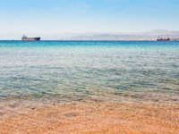 Клуб путешествий Павла Аксенова. Иордания. Акаба. View on Israel mountain through Red Sea from Aqaba port. Фото Valery Voennyy - Depositphotos