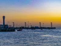 Клуб путешествий Павла Аксенова. Иордания. Акаба. Sunset view of a port at Aqaba, Jordan. Фото Dudlajzov - Depositphotos