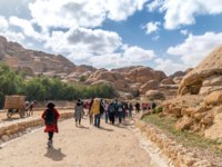 Иордания. Петра. Tourists are walking in Petra, Jordan. Petra is one of the New Seven Wonders of the World. Фото Robson90 - Depositphotos
