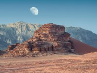 View on Red Sand Dune in incredible lunar landscape in Wadi Rum in the Jordanian desert with huge moon above. Фото leshiy985 - Depositphotos