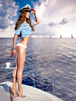 Мальдивы. Maldives. Attractive girl on a yacht at summer day. Фото Andrey Bayda - Depositphotos