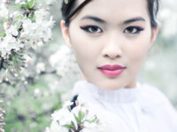 Young woman with cherry flowers. Shallow dof effect. Фото chaoss - Depositphotos