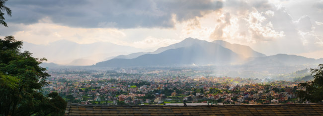 Panorama of Kathmandu valley, with cloudy sky and sunset, town and hills, from Shivapuri Nagsrjun National Park in Nepal. Фото Emcampos - Depositphotos