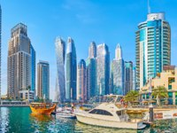 Dubai Marina cityscape with a view on canal, harbor of Bristol Charter with moored wooden dhow boat. Фото efesenko - Deposit