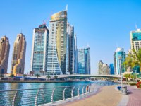 Dubai Marina opens scenic views on modern buildings, canal and topiary gardens in Dubai. Фото efesenko - Depositphotos