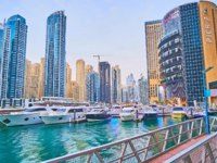ОАЭ. Дубай Марина. The shipyard with moored yachts and boats at the building in Dubai Marina. Фото efesenko - Deposit