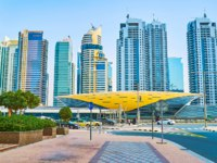 Damac Properties metro station in front of luxury Jumeirah Lake Towers complex in Dubai. Фото efesenko - Depositphotos