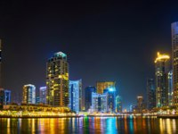 ОАЭ. Дубай. Район Дубай Марина. Panorama of the evening Dubai Marina in waters of canal in Dubai. Фото efesenko - Depositphotos