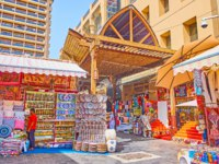 The Bur Dubai Grand Souq has atmosphere of classic Eastern market with large amount of interesting goods and souvenirs in Dubai. Фото efesenko - Depositphotos