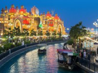 ОАЭ. Дубай. Всемирная деревня. Canal with pleasure boats in the park entertainment center Global Village in Dubai. UAE. Фото Observer - Depositphotos