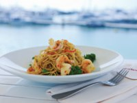 Jumeirah Beach Hotel. Waterfront Whole wheat Spaghetti grilled king prawns broccolini garlic lemon chili and parsley