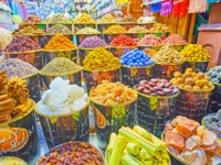 The large amount of spices, herbs, flower tea, nuts, rock salt and minerals for skin and body care in Grand Souq, Deira in Dubai. Фото efesenko - Depositphotos
