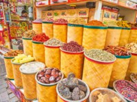 The store of Deira Grand Souq (market) with wide range of spices, herbs, dried fruits, nuts and flower tea in Dubai. Фото efesenko - Depositphotos