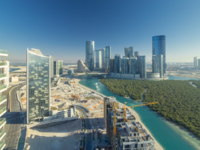 ОАЭ. Абу-Даби. Buildings on Al Reem island in Abu Dhabi timelapse from above. Aerial citiscape of Al Reem Island. Фото neiezhmakov. Depositphotos