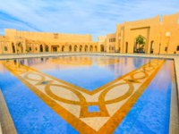 "Катар. Доха. Этнографическая деревня ""Катара"". Katara Mall at Katara Cultural Village reflecting in a tiled pool in West Bay District, Doha. Фото bennymarty-Deposit"