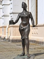 Sculpture of a conductress with two glasses of tea next to the Old railway station building. The sculpture by sculptors Yury Krylov and Alexander Koroteev was installed