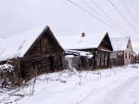 Золотое кольцо России. Гороховец. Small town street in winter. Snowbound huts. Gorohovets, Russia. Фото Orininskaya - Depositphotos