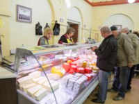 Кострома. Unidentified people buy food at the Kostroma cheese exchange. The store presents products of different cheesemakers in the Kostroma region. YuliaB-D