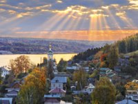 Плес. Russia. Ples. The city in the Ivanovo region on the Volga river in the rays of the through the clouds and bell tower of the Resurrection Church. Фото yulenochekk-Depo