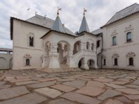 Ростовский кремль. Красная палата. Bright two-storey building with a stone porch with weathervanes on a stone-paved area. Фото owsigor53@gmail.com-Deposit