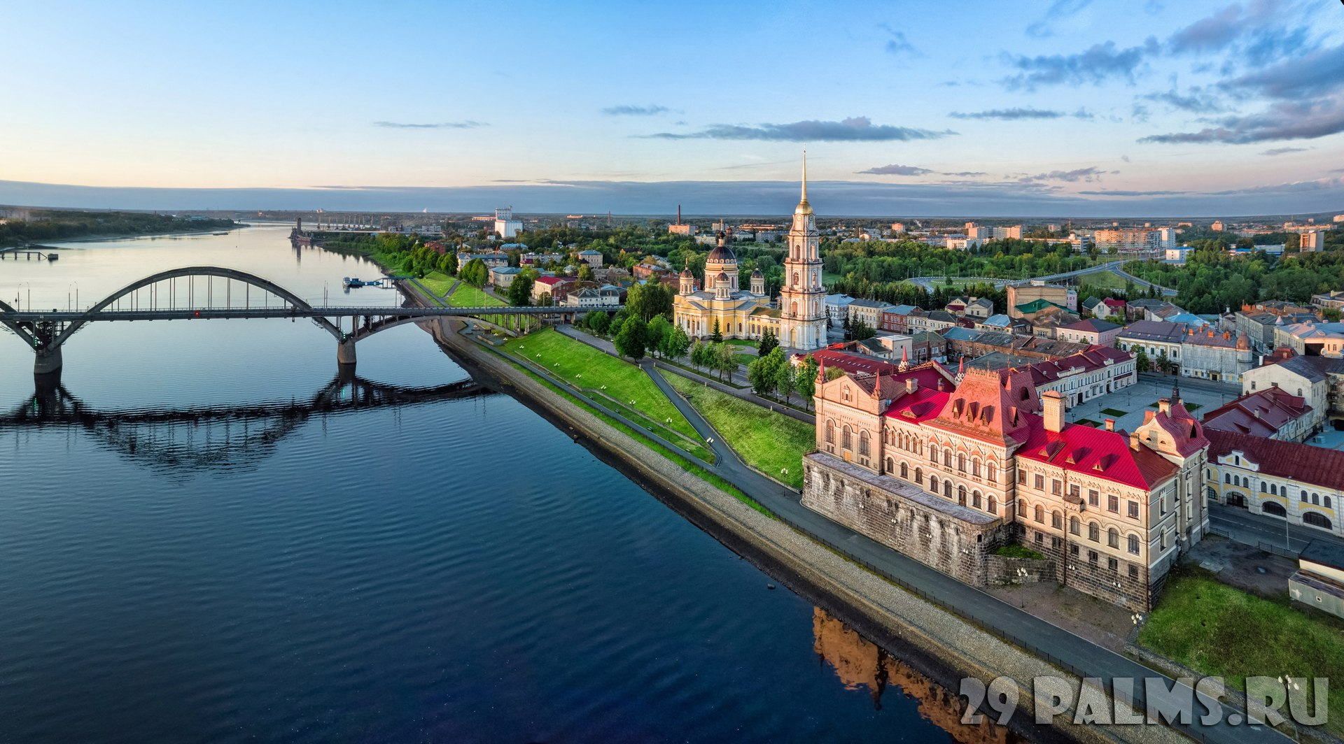 Россия. Ярославская область. Рыбинск.  Aerial cityscape of Rybinsk Volga river embankment, cathedral and bridge. Russia. Фото bbsferrari - Depositphotos