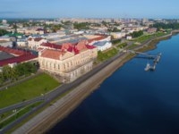 Россия. Рыбинск. Old building of the Bread Exchange on the embankment of the Volga River in the cityscape on a July morning. Rybinsk. Фото sikaraha - Depositphotos