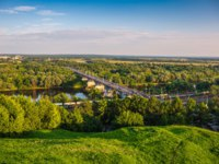 Золотое кольцо России. Владимир. Panoramic view of bridge over river Klyazma in Vladimir city with railroad and green trees. Фото DedMityay-Deposit
