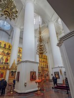 Interior view of Assumption Cathedral - decorated golden altar and white columns and ceiling. Famous touristic place at Golden Ring tour in Russia. Фото Igor-SPb - Depositphotos