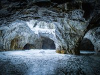 Cave in winter. Ruskeala. Marble quarry. Extraction of marble. Karelia. Russia. The Republic of Karelia. Marble steed. Caves in Ruskeala. Фото GrinPhoto-Deposit