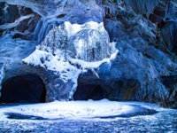 Winter Cave. Snow-covered cave. The Republic of Karelia. The village of Ruskeala. Karelia in the winter. Russia. Фото GrinPhoto - Depositphotos