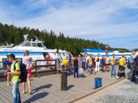Клуб путешествий Павла Аксенова. Россия. Карелия. Остров Валаам. Tourists stand on pier of Valaam Monastery. Фото vodolej-Depositphotos