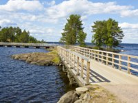 Россия. Карелия. Остров Валаам. Landscape of island Valaam on Ladoga lake on North of Russia, wooden bridge between islands. Фото Afonskaya-Depositphotos