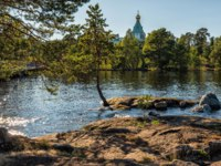 The lake is surrounded by St. Nicholas Skete. The wonderful island Valaam is located on Lake Lodozhskoye, Karelia. Фото GeneralSky-Depositphotos