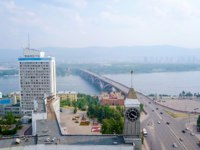 Россия. Красноярск. The city clock. Communal bridge, the city administration. Panorama of the city of Krasnoyarsk, Russia. Фото MaykovNikita - Depositphotos