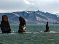 Three Brothers Rocks in Avachinskaya Bay (Avacha Bay) in Pacific Ocean - popular travel destinations on Kamchatka Peninsula. Фото AlexanderPiragis - Depositphotos